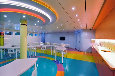 Multi coloured dining area with ceiling lights and orange kitchen units